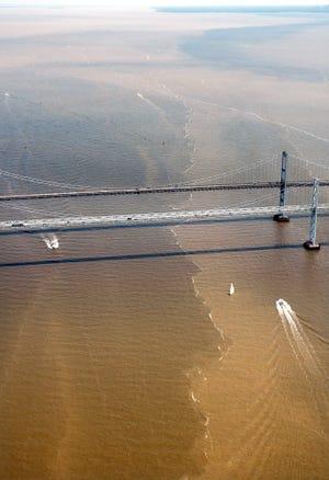 Sediment-laden plumes converge around the Chesaspeake Bay Bridge in Maryland following huge rainstorms in 2006.