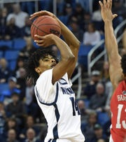 Nevada's Lindsey Drew shoots for three against UNLV's Bryce Hamilton earlier this season.
