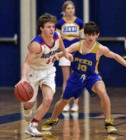 Reno's Drue Worthen dribbles the ball while guarded by Reed's Jace Cook during Tuesday's game at Reno.
