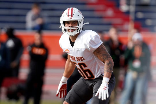 Wisconsin's Zack Baun lines up as the North squad runs drills during practice for the Senior Bowl Wednesday.