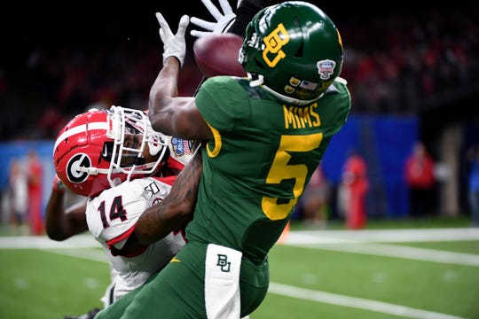Baylor wide receiver Denzel Mims tries to pull in a pass as Georgia defensive back DJ Daniel defends in the first half of the Sugar Bowl .
