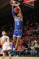UCLA's Jules Bernard (3) makes it past Oregon State's Tres Tinkle (3) to dunk during the first half of an NCAA college basketball game in Corvallis, Ore., Thursday, Jan. 23, 2020.