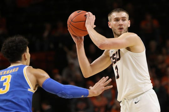 Oregon State's Tres Tinkle (3) looks for a way around UCLA's Jules Bernard (3) during the first half of an NCAA college basketball game in Corvallis, Ore., Thursday, Jan. 23, 2020.