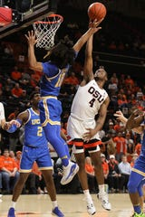 UCLA's Tyger Campbell (10) blocks a basket by Oregon State's Alfred Hollins (4) during the first half of an NCAA college basketball game in Corvallis, Ore., Thursday, Jan. 23, 2020.