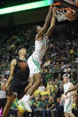 Oregon's C.J. Walker, right, dunks the ball past Southern California's Isaiah Mobley, left, during the first half of an NCAA basketball game in Eugene, Ore., Thursday, Jan. 23, 2020.