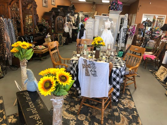 The main showroom in Shabby Chic of Dreams uses antique furniture to display items. The furniture can be purchased.
