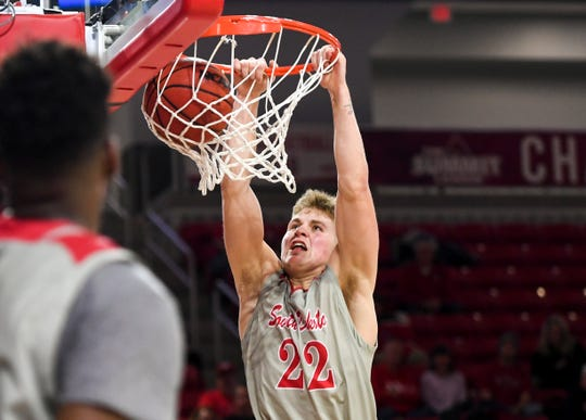 USD's Tyler Peterson (22) makes a dunk to end the first half of the game against Purdue Fort Wayne on Thursday, Jan. 23, 2020 at the Sanford Coyote Sports Center in Vermillion, S.D.