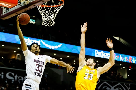 Missouri State Bears forward Josh Hall (33) carries the ball for a field goal as Valparaiso Crusaders forward John Kiser (33) attempts to block the shot during a game at JQH Arena on Thursday, Jan. 23, 2020.