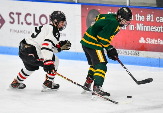 St. Cloud's Blake Keller concentrates on the puck controlled by Brandon Bokelman of Sauk Rapids during the game Thursday, Jan. 23, 2020, at the MAC in St. Cloud.