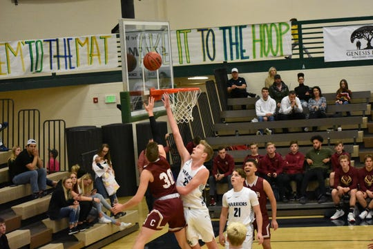 Cedar's Landon Barney puts up a layup against Snow Canyon on January 21, 2020.