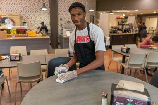 High school senior Ja'Quez Bivens earns credit hours for his work at FSU's Seminole Café.