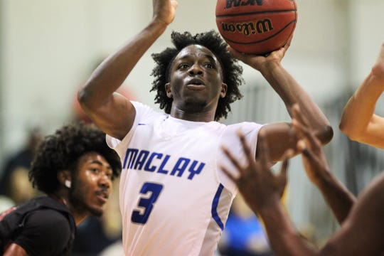 Maclay junior O'rell Brooks drives to the basket as Maclay's boys basketball team beat Chiles 45-42 on Jan. 23, 2020.