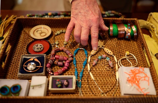 Retiree Kermit Brown points out some of his more intricate jewelry pieces he has made during his free time.