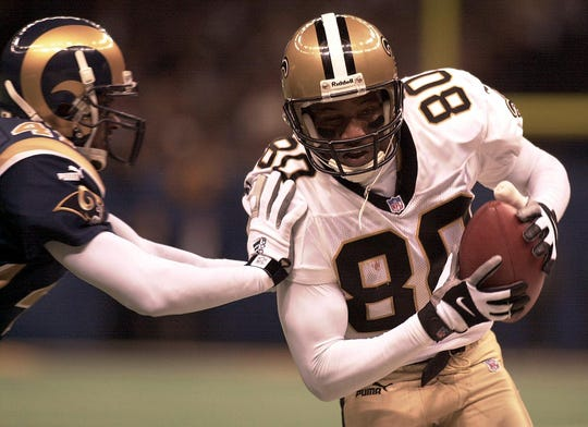 New Orleans Saints receiver Robert Wilson gets shoved out of bounds by St. Louis Rams' Jeff Robinson during second quarter action of their NFC Wild Card game on Dec. 30, 2000 at the Superdome in New Orleans.