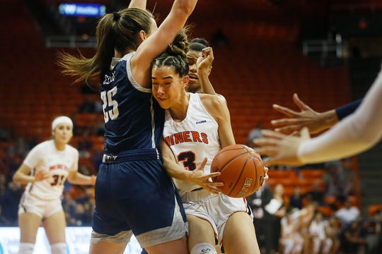 UTEP's Katia Gallegos goes against Rice defense during the game Thursday, Jan. 23, at the Don Haskins center in El Paso.
