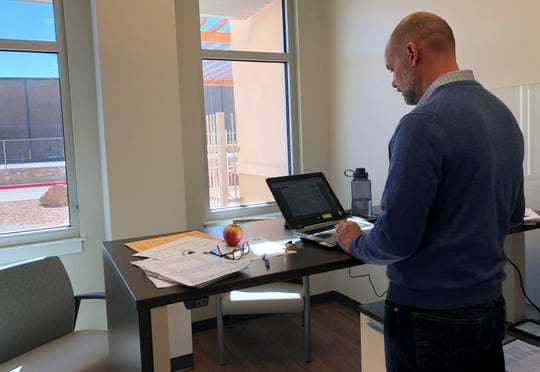 Psychologist Mark Menzies, general mental health program manager for the El Paso VA Health Care System, works Jan. 24 in his office in the new VA mental health clinic in the Medical Center of the Americas campus in South Central El Paso.
