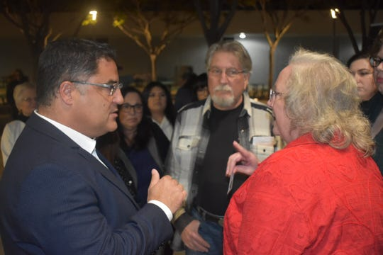 Congressional candidate Cenk Uygur, left, chats with people outside a Simi Valley forum Thursday night for California's 25th Congressional District.