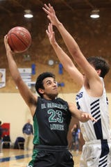 El Diamante's Rajan Batth (23) shoots over the top of Redwood defender in a West Yosemite League high school boys basketball game on Thursday, January 23, 2020.