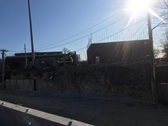 Work on the new headquarters of The Stagg Group development company at One Bradford Road in Mount Vernon has included a small brick building, right, that has not been approved and was not even on the plans submitted to the city.