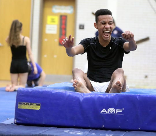 Ossining's Cruz Vernon laughs after a tumbling pass during gymnastic practice at Anne M. Dorner Middle School in Ossining Jan. 22, 2020.