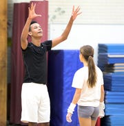 Ossining's Cruz Vernon talks to his teammate during gymnastic practice at Anne M. Dorner Middle School in Ossining Jan. 22, 2020.