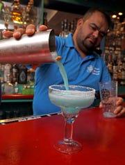 Cesar Lemus makes Something New Something Blue Margarita at Sangria's Restaurant in Congers Jan. 23, 2020.