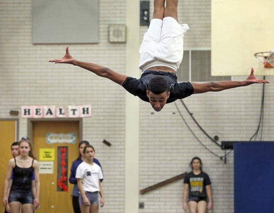 Ossining's Cruz Vernon works on tumbling pass during gymnastic practice at Anne M. Dorner Middle School in Ossining Jan. 22, 2020.