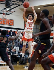 White Plains' Tymir Greene (11) goes up for a shot against Mt. Vernon during boys basketball action at White Plains High School Jan. 23, 2020. White Plains won the game 67-66.