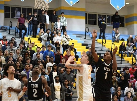 Drew Zimmerman (5) and Collin Mallet (13) of Cape Henlopen and Skylar Johnson (2) and Jordan Harper (1) of Sussex Tech look up for a rebound during Sussex Tech's 63-62 win on Thursday night at Cape Henlopen. Ejections following a fight left each team with only three players over the final 12 minutes.