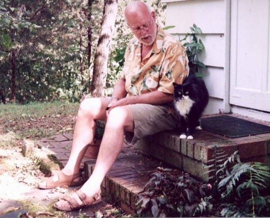 "Former News Journal reporter and editor Shaun Mullen pictured with his cat Kiko. After retiring from the journalism industry, Mullen started a blog named ""Kiko's House."""