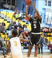 Sussex Tech's Devon Reynolds (5) shoots over Cape Henlopen's Kris Rushin during Sussex Tech's 63-62 win on Thursday night at Cape Henlopen. Ejections following a fight left each team with only three players over the final 12 minutes.