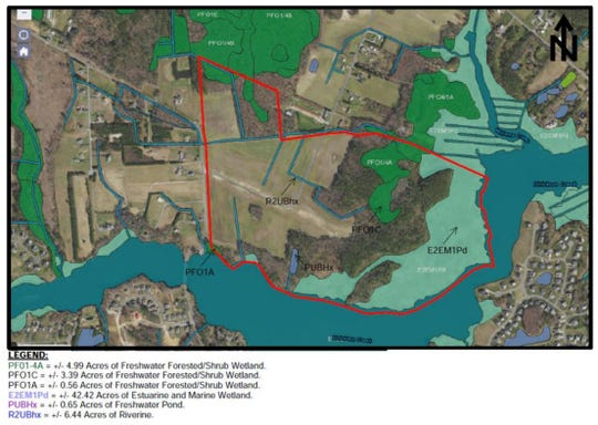 This image of the Old Mill Landing neighborhood proposal, outlined in red, shows what kind of wetlands exist.