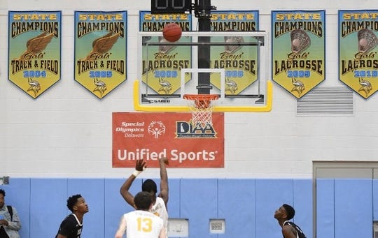 A Cape Henlopen player shoots a free throw with only two Sussex Tech players available to rebound during Sussex Tech's 63-62 win on Thursday night at Cape Henlopen. Ejections following a fight left each team with only three players over the final 12 minutes.