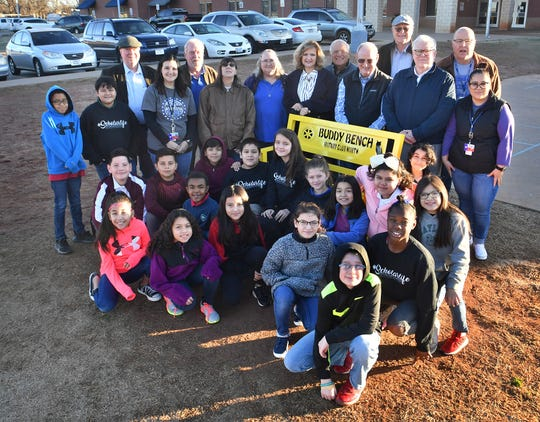 Members of Rotary Club North, Scotland Park Elementary staff and students gather around the new Buddy Bench installed at the school.