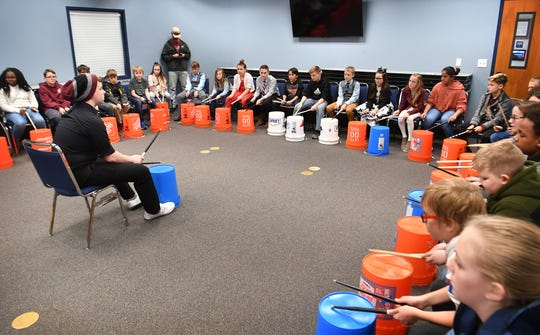 Gabe Damron of the Wichita Falls Youth Symphony Orchestra teaches groups of fifth grade students from Bowie and Petrolia the basics of drumming and percussion during Fine Arts Discovery Day at Region 9 Education Service Center Friday.