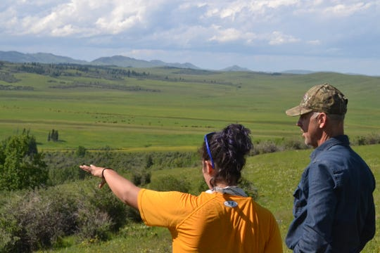 Researcher Naomi Louchouarn, and Joe Englehart, discuss camera placement on the field site.