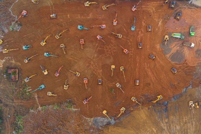 An aerial view of the construction site of a field hospital in Wuhan, Hubei province, China on January 24, 2020. The 1,000-bed hospital is expected to be completed by February 3, 2020 to cope with the increasing number of people affected by the coronavirus.