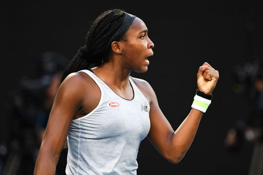 Coco Gauff celebrates during her third-round upset of Naomi Osaka at the Australian Open.