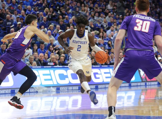 Kentucky forward Kahlil Whitney dribbles the ball against Evansville during the first half at Rupp Arena.