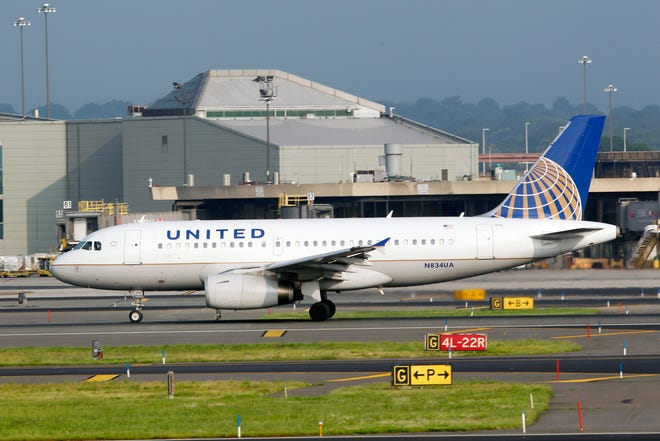 An Airbus A320 United Continental passenger plane rolls on take off at Newark Liberty International airport.