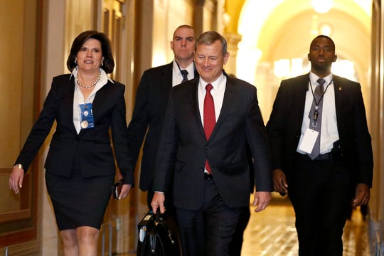 Supreme Court Chief Justice John Roberts, second from right, arrives at the Capitol in Washington during the impeachment trial of President Donald Trump on Friday.
