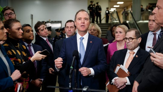 Lead House impeachment manager Adam Schiff, center, standing with other managers prior to the impeachment trial on Friday.
