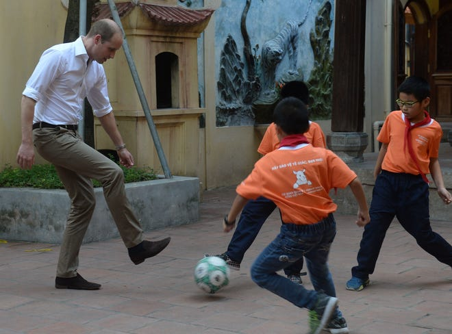 Prince William plays soccer with local schoolboys in Hanoi during his two-day visit to Vietnam in November 2016.