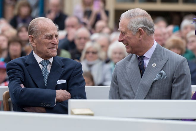 Prince Charles jokes with his father, Prince Philip, before an event in Poundbury, England, in October 2016.