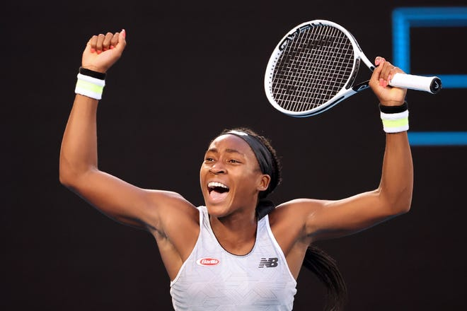 Coco Gauff of the U.S. celebrates after victory against Japan's Naomi Osaka during their women's singles match on day five of the Australian Open tennis tournament in Melbourne on January 24, 2020. (