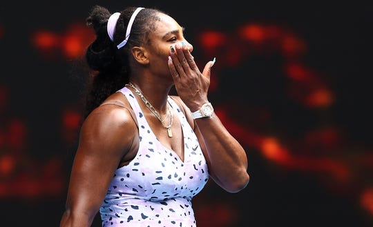 Serena Williams of the United States reacts after losing her third-round match against Qiang Wang.