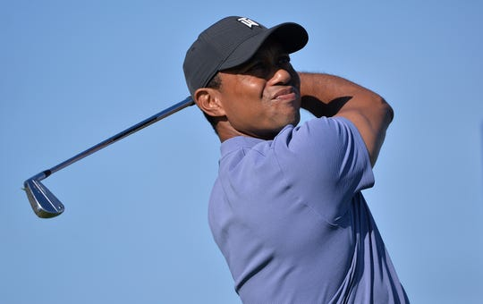Tiger Woods shot a 3-under 69 on the North Course in the first round of the Farmers Insurance Open at Torrey Pines Municipal Golf Course.