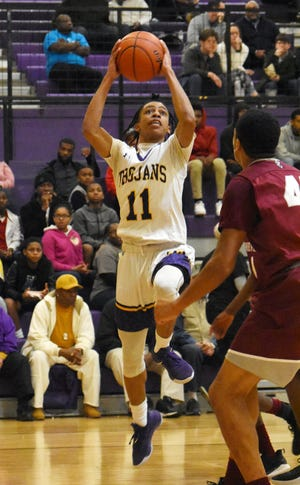 Alexandria Senior High senior Dez McQuain (11) skies for a layup against Pineville in the Red River Rivalry held Friday, Jan. 24, 2020.