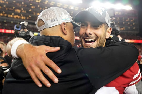 San Francisco 49ers quarterback Jimmy Garoppolo, right, celebrates with assistant coach Miles Austin after the NFL NFC Championship football game against the Green Bay Packers Sunday, Jan. 19, 2020, in Santa Clara, Calif. The 49ers won 37-20 to advance to Super Bowl 54 against the Kansas City Chiefs.