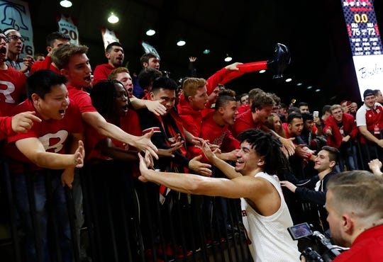 Rutgers Scarlet Knights guard Geo Baker (0) celebrates with fans after defeating the Nebraska Cornhuskers